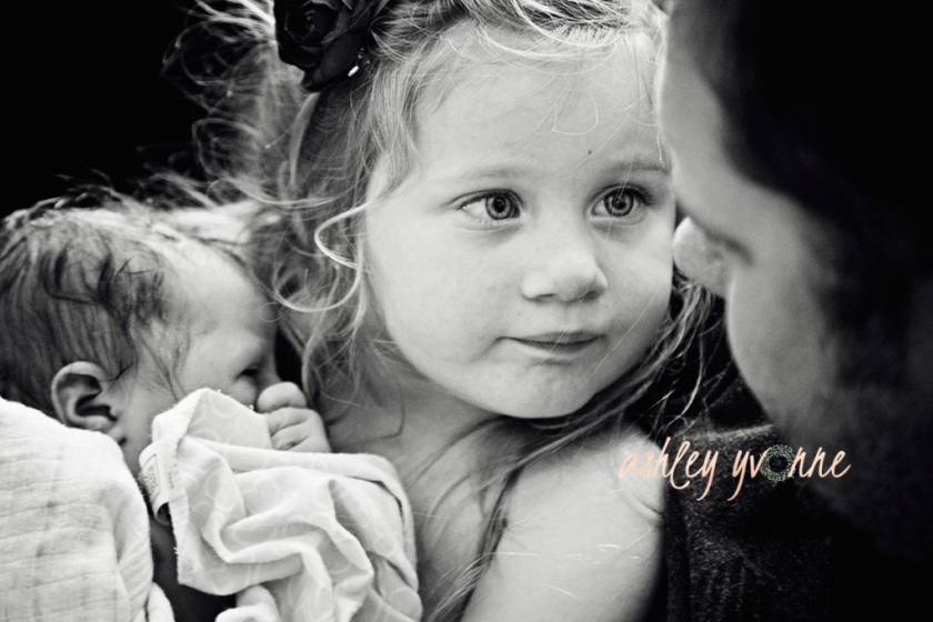 Little girl looking at her father